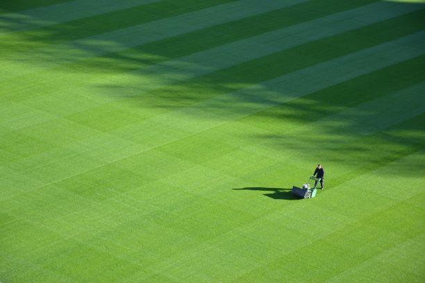 Man mowing a baseball field